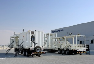 A self-contained trailer mounted well test package sits outside the companies Jebel Ali facility